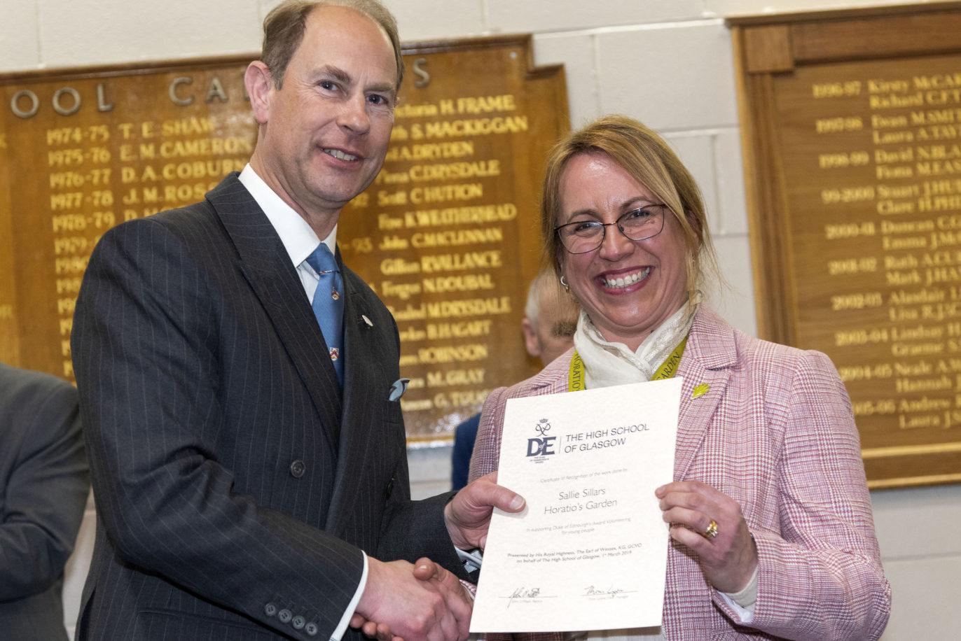 head gardener for Horatio's garden scotland receives certificate from the earl of wessex