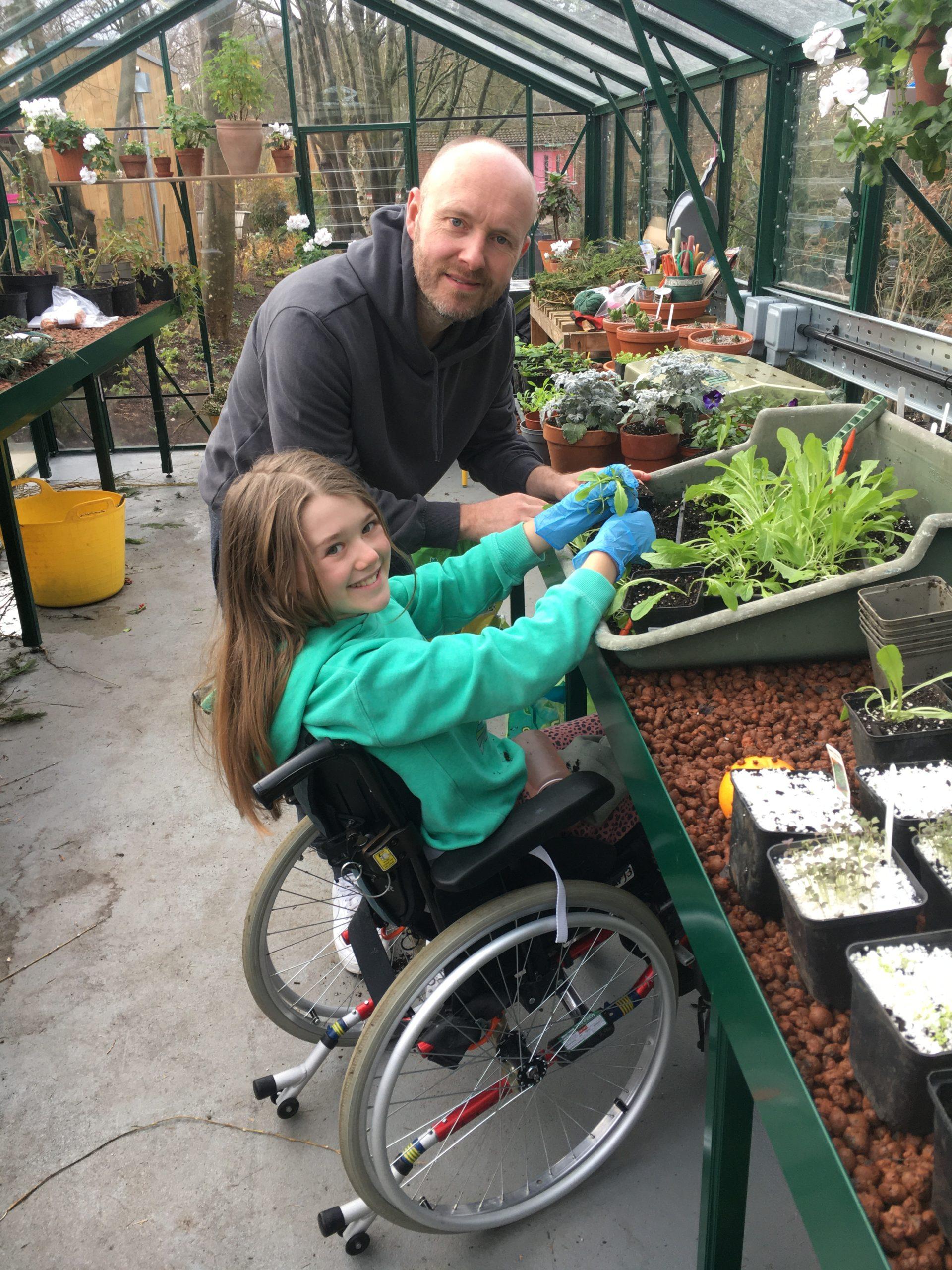 Scarlett in the greenhouse
